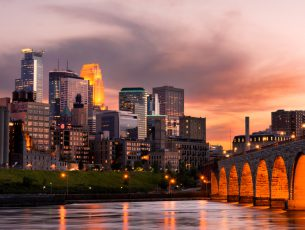 Minneapolis Minnesota Downtown and the Stone Arch Bridge at Sunset
